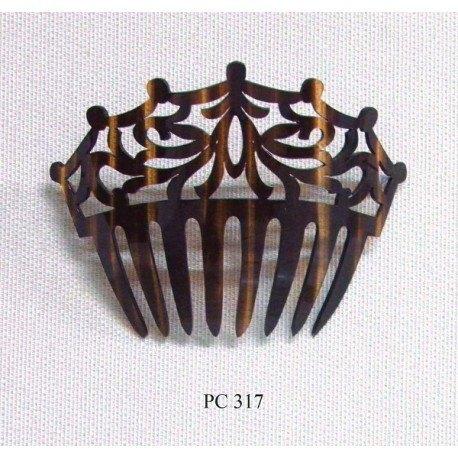Peinecillo  fabricado en celuloide.